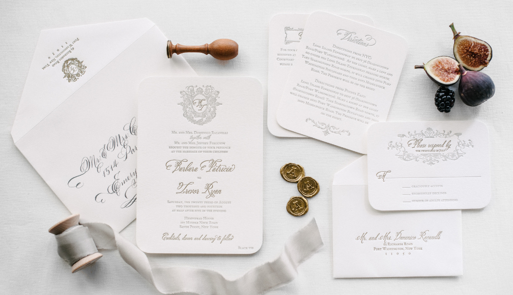 Elegant and classic monogram letterpress wedding invitation set for a celebration at Hempstead House, as seen in the Knot Weddings