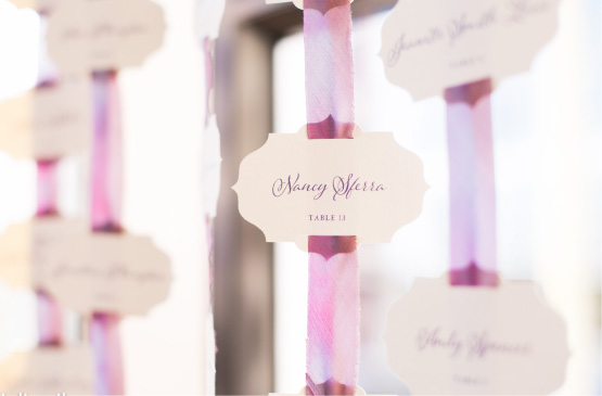 Wedding Place card die cut in elegent frame shape held up by purple ribbon | Elegant, Classic, Calligraphy